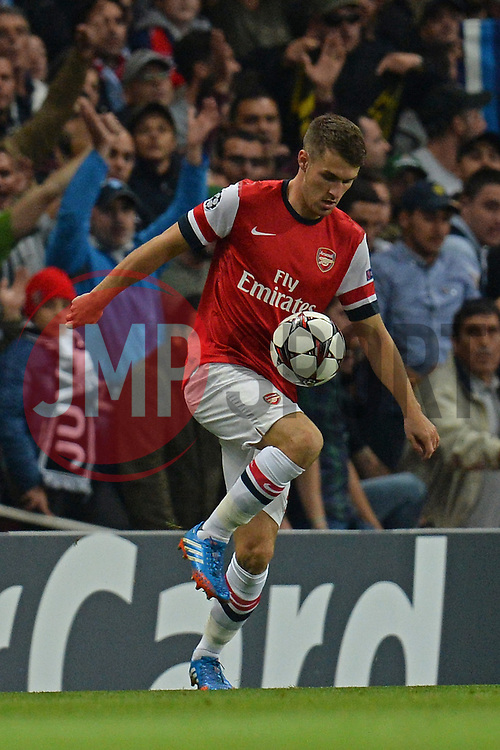 LONDON, ENGLAND - Oct 01: Arsenal's midfielder Aaron Ramsey from Wales  during the UEFA Champions League match between Arsenal from England and Napoli from Italy played at The Emirates Stadium, on October 01, 2013 in London, England. (Photo by Mitchell Gunn/ESPA)