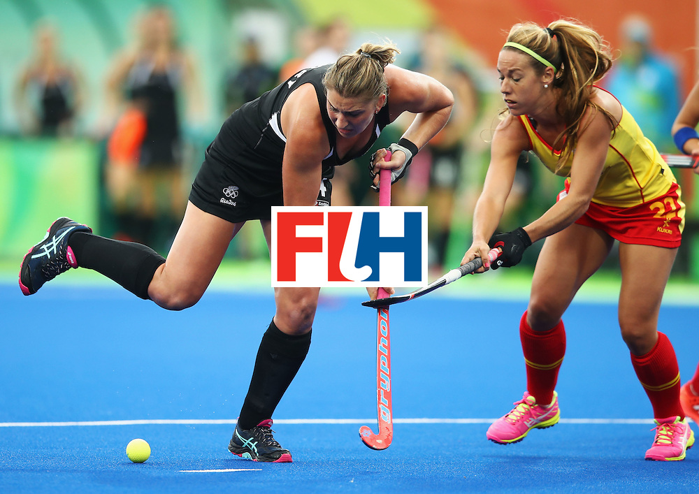 RIO DE JANEIRO, BRAZIL - AUGUST 10:  Olivia Merry of New Zealand is challenged by Gloria Comerma of Spain during the Women's Pool A Match between Spain and New Zealand on Day 5 of the Rio 2016 Olympic Games at the Olympic Hockey Centre on August 10, 2016 in Rio de Janeiro, Brazil.  (Photo by Mark Kolbe/Getty Images)