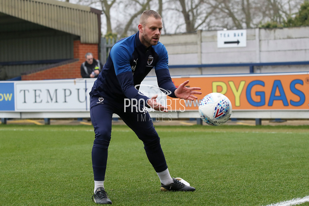 AFC Wimbledon fitness coach Jason Moriarty warming up during the EFL Sky Bet League 1 match between AFC Wimbledon and Southend United at the Cherry Red Records Stadium, Kingston, England on 1 January 2020.