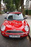 Red Mini One car parked in a parking bay  in a London street, England, United Kingdom