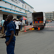 A police man takes guard at the scene of a grenade attack outside local shop in central Bujumbura. Eight people were injured in the attack.