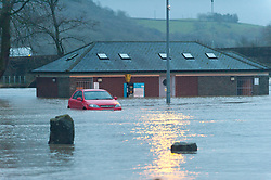 © Licensed to London News Pictures. 16/02/2020.  Builth Wells, Powys, Wales, UK. The Groe car park and recreation area is flooded. The river Wye bursts it's banks at Builth Wells in Powys, Wales, UK. after heavy rainfall yesterday and last night, causing the A483 road to be closed and traffic diverted. The river level broke the all-time high (5.05 m) at 08.30hrs  this morning at Builth Wells. According to Natural Resources Wales the highest recorded level at Builth Wells was 4.95m on 28/10/98 at 2:45 am (GMT) Photo credit: Graham M. Lawrence/LNP