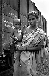 BANGLADESH DINAJPUR OCT94 - Homeless woman with her child poses for a photo near a goods train at Dinajpur station, northern Bangladesh...jre/Photo by Jiri Rezac..© Jiri Rezac 1994