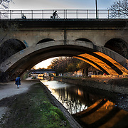 WASHINGTON, DC - MAR23: Pedestrians, joggers, and cyclists, enjoy the towpath of the Chesapeake and Ohio (C&O) Canal in Georgetown, March 23, 2017.  There is no lighting along the canal and much of it is lined with graffiti. Georgetown Heritage, the National Park Service, and the DC Office of Planning are planning to upgrade the one mile stretch of the C&O Canal that runs through Georgetown to create a destination experience like the Highline in New York City. (Photo by Evelyn Hockstein/For The Washington Post)