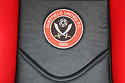 Sheffield United crest on seat in substitutes bench before during the EFL Sky Bet Championship match between Sheffield United and Bolton Wanderers at Bramall Lane, Sheffield, England on 2 February 2019.