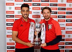 CARDIFF, WALES - Thursday, August 31, 2017: Wales' Neil Taylor and Joe Allen with the trophy during the 2nd round draw for the FAW Welsh Premier League Cup at the Vale Resort. (Pic by David Rawcliffe/Propaganda)