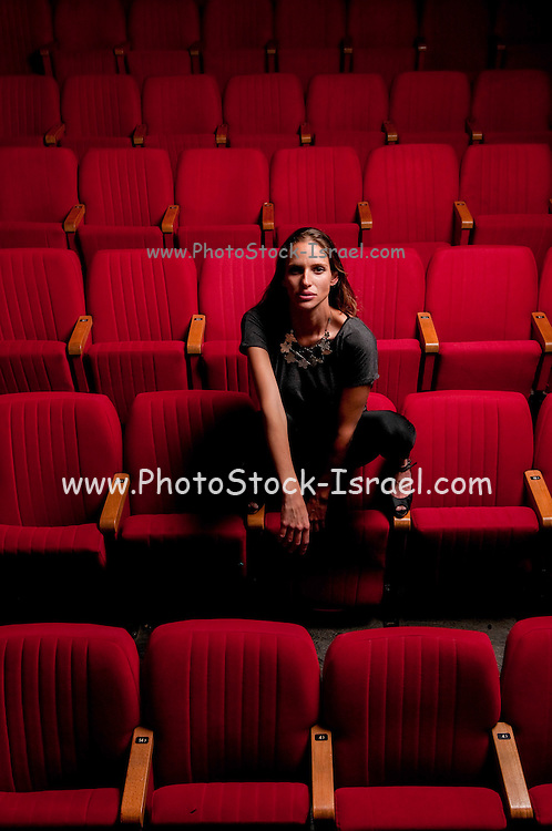 One woman alone in a theatre hall model release available