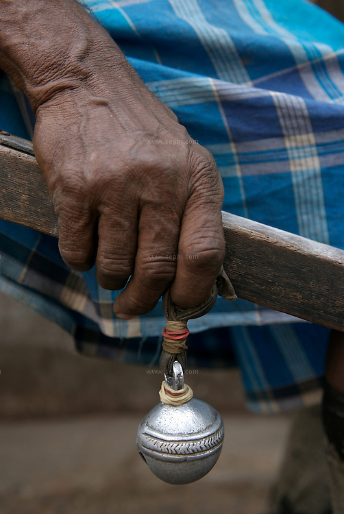 "A rickshaw puller holding his metalic bell, a part of the standard equipment for every rickshaw puller in the city...The hand-pulled rickshaw of Calcutta, immortalised by Dominic Lapierre's famous novel, City of Joy, will soon be a part of the history books as a bill passed by the West Bengal state assembly described the centuries-old mode of transport as ""inhumane."".The future of about 18,000 rickshaw pullers in the city, earning an avarage daily wages of about 100 rupees ($2.5).is unclear as they call for a compensation package to help them rehabilitate into alternative jobs."