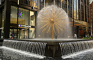 NYC, New York, U.S.  21st May 2013.  The fountain sculpture on Avenue of the Americas looks like a dandelion spouting water, during the pleasant spring day, with a high of 86ºF/32ºC in Manhattan.
