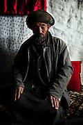 Ibrahim, 67, father of 9, is sitting in the cave where he lives with his family since seven years, in Bamyan, central Afghanistan, an area mostly populated by Hazaras. A historically persecuted minority (15%) due to more lenient Islamic faith and characteristic 'Eastern' lineaments, Hazaras constitute the 70% of Bamyan's population.