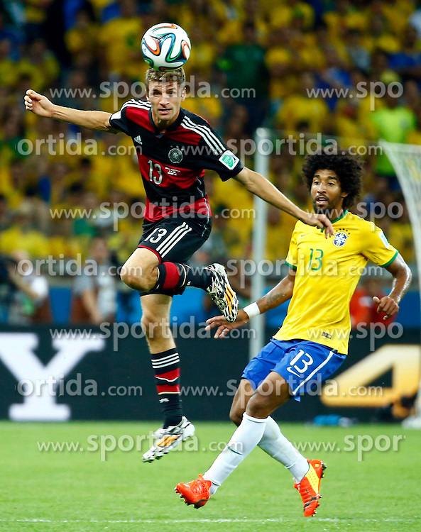 08.07.2014, Mineirao, Belo Horizonte, BRA, FIFA WM, Brasilien vs Deutschland, Halbfinale, im Bild Brazil's Dante vies with Germany's Thomas Muller // during Semi Final match between Brasil and Germany of the FIFA Worldcup Brazil 2014 at the Mineirao in Belo Horizonte, Brazil on 2014/07/08. EXPA Pictures &copy; 2014, PhotoCredit: EXPA/ Photoshot/ Chen Jianli<br /> <br /> *****ATTENTION - for AUT, SLO, CRO, SRB, BIH, MAZ only*****