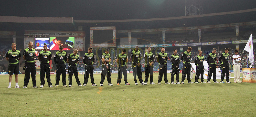 Warriors stand for a minutes silence during match 1 of the NOKIA Champions League T20 ( CLT20 )between the Royal Challengers Bangalore and the Warriors held at the  M.Chinnaswamy Stadium in Bangalore , Karnataka, India on the 23rd September 2011..Photo by Shaun Roy/BCCI/SPORTZPICS