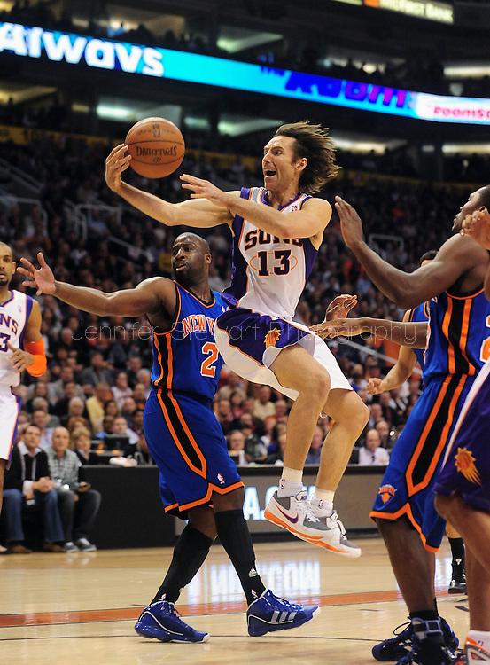 Jan. 7 2011; Phoenix, AZ, USA; Phoenix Suns guard Steve Nash (13) puts up the ball against New York Knicks guard Raymond Felton (2) during the first half at the US Airways Center. Mandatory Credit: Jennifer Stewart-US PRESSWIRE.