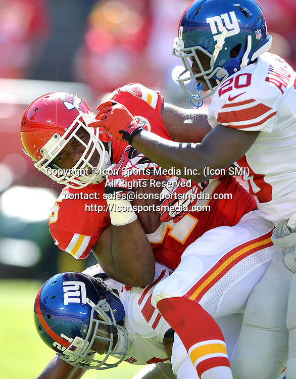 September 29, 2013 - Kansas City, KS, USA - Kansas City Chiefs tight end Kevin Brock (46) hauls in a 25-yard pass and is brought down by New York Giants cornerback Prince Amukamara (20) and free safety Ryan Mundy (21) during the fourth quarter at Arrowhead Stadium in Kansas City, Missouri, on Sunday, September 29, 2013. The Chiefs won, 31-7