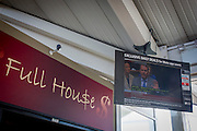 Seen on a TV screen inside the Moto Services on the M4 motorway, near Heathrow airport, London England, Conservative MP, Dr Liam Fox speaks in favour of military action against the Assad government in Syria during an emergency debate in the House of Commons, the parliament of the United Kingdom, a pun on the term Full House.