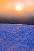 Windblown snow and sunset from the summit of Sentinel Dome, Yosemite National Park, California