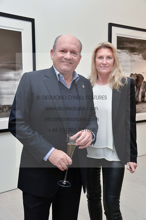 MICHAEL SPENCER and SARAH, MARCHIONESS OF MILFORD-HAVEN at a private view of photographs by wildlife photographer David Yarrow included in his book 'Encounter' held at The Saatchi Gallery, Duke of York's HQ, King's Road, London on 13th November 2013.