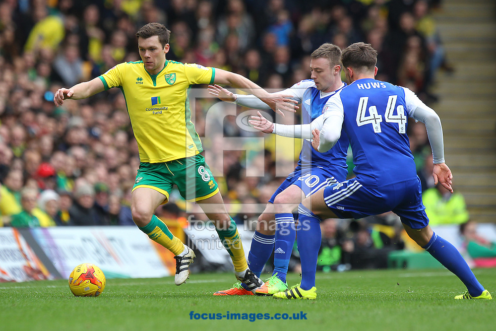 Jonny Howson of Norwich, Freddie Sears of Ipswich Town and Emyr Huws of Ipswich Town in action during the Sky Bet Championship match at Carrow Road, Norwich<br /> Picture by Paul Chesterton/Focus Images Ltd +44 7904 640267<br /> 26/02/2017