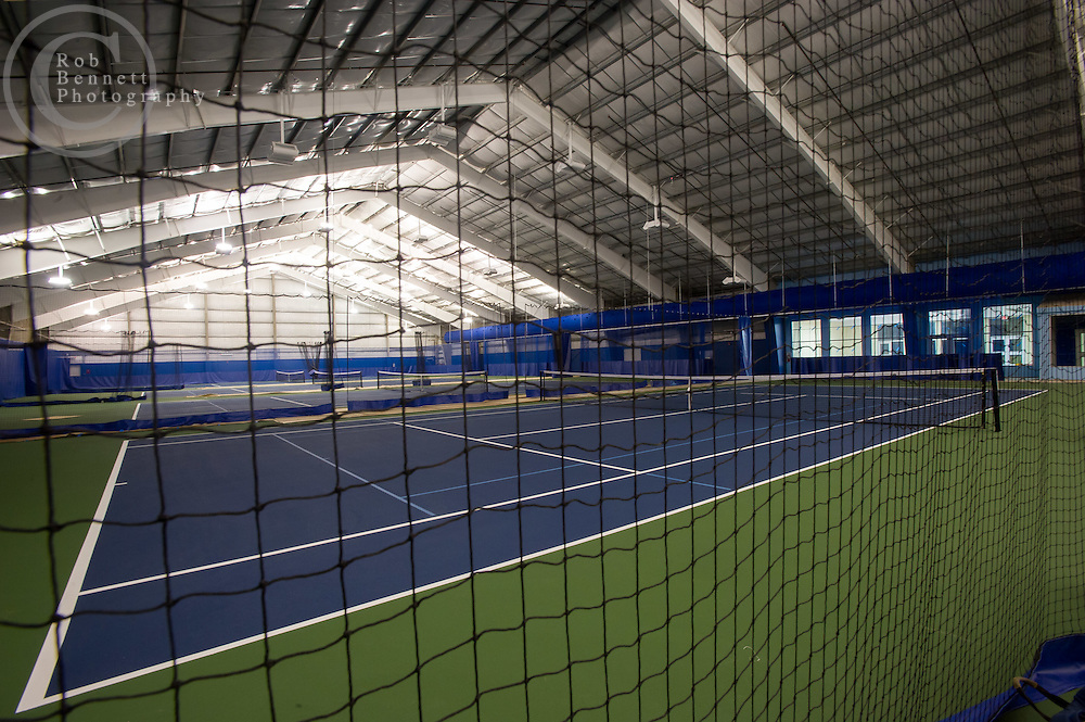 Jun 21, 2012 : Here, tennis center with seven indoor hard court tennis courts (photo only showing some)..--.Images of Chelsea Piers in Stamford, CT -  a 400,000-square-foot sports and recreation facility slated to open in late June. The space is designed by the same architect who did the New York Chelsea Piers, Jim Rogers. But unlike the water views in New York, the space in Connecticut is land locked without interesting views. So instead of bringing the outside in, Rogers designed a facility that is full of windows on the inside so as you enter you can see into the space with open staircases and mezzanines. Credit: Rob Bennett for The Wall Street Journal Slug: NYCHELSEA