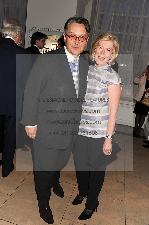 TOMASZ STARZEWSKI and ANNE SINGER at a reception to present the new Cartier Tank Watch Collection held at The Orangery, Kensington Palace Gardens, London W8 on 19th April 2012.