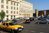 Azerbaijan, Baku. Traffic in Baku. Walls are surrounding the Old City or Inner City of Baku. This is the historical core of Baku.