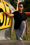 Bryan Harper - farmer, pilot - climbing aboard his Harvard.