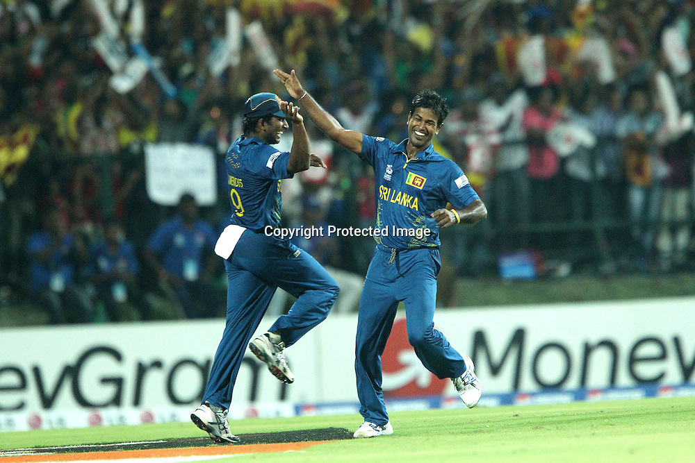 Jeewan Mendis and Nuwan Kulasekara celebrate the wicket of Chris Gayle of The West Indies during the ICC World Twenty20 Super 8s match between Sri Lanka and The West Indies held at the  Pallekele Stadium in Kandy, Sri Lanka on the 29th September 2012<br /> <br /> Photo by Ron Gaunt/SPORTZPICS