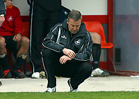 Photo: Paul Thomas.<br /> Blackpool v Swansea City. Coca Cola League 1. 15/04/2006.<br /> <br /> Swansea manager Kenny Jackett looks at his watch as time runs out for his team.
