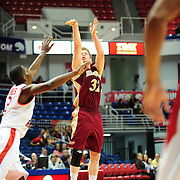 Denver's guard, Chase Hallam (32), takes a jump shot in the first half of play in Mobile, AL. Denver leads South Alabama 30-24 at halftime on January 7, 2012...