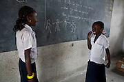 March 2009. Kinshasa, Ikisi District, DRC. Children are encouraged in role-play to practice their French language skills.