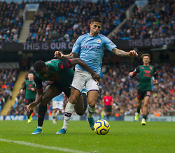 Keinan Davis of Aston Villa (L) and Joao Cancelo of Manchester City in action - Mandatory by-line: Jack Phillips/JMP - 26/10/2019 - FOOTBALL - Etihad Stadium - Manchester, England - Manchester City v Aston Villa - English Premier League