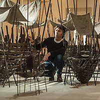 London, UK - 2 September 2014: Artist Xavier Mascaró poses next to 'Departure', a poignant and imposing installation of boats made from bronze and iron which are evocative of long-forgotten shipwrecks. Xavier Mascaró's first UK solo exhibition will run from 3 September until 5 October at Saatchi Gallery.