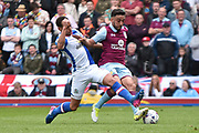 Blackburn Rovers Midfielder, Elliott Bennett (31) and Aston Villa Defender, Neil Taylor (3) during the EFL Sky Bet Championship match between Blackburn Rovers and Aston Villa at Ewood Park, Blackburn, England on 29 April 2017. Photo by Mark Pollitt.