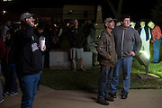 Somervell County residents watch as the primary election results are posted outside the county courthouse on March 1, 2016 in Glenn Rose, Texas.  (Cooper Neill for The New York Times)