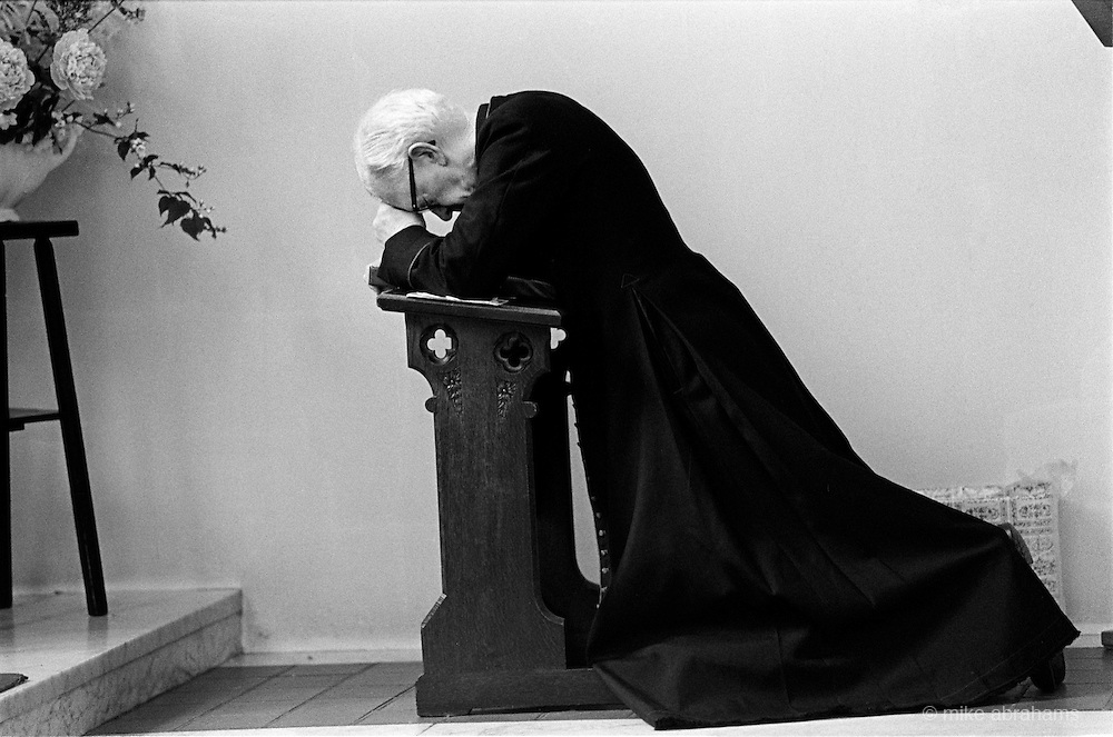 Priest at prayer at the Convent of the Holy Name, Malvern