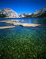 Waist Deep And halfway Across Lake Tenaya On A Beautiful Summers Day At Yosemite National Park, California, USA