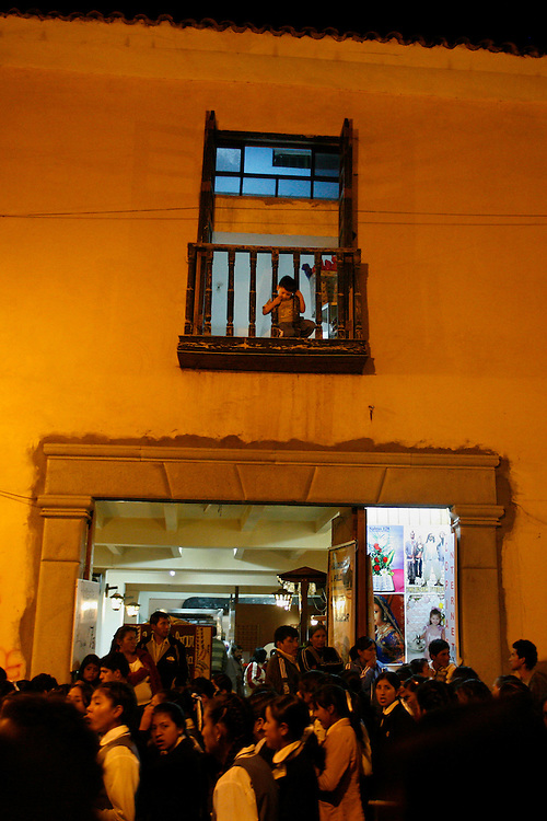 """A young boy watches the procession for Saint Mary in Ayacucho, Peru, ((lat -13.1548°, long -74.2044°, Altitude: 9,202 Feet - http://www.fallingrain.com/world/PE/5/Ayacucho.html), Wednesday night, May 14, 2008. The procession continued from the Plaza de Armas to all the the major cathedrals, of which there are more than 33, one for every year that Christ was alive, in this city known as as """"Sevilla Peruana"""" for its religious festivities of Semana Santa (Holly Week) and """"Ciudad de las Iglesias"""" (city of the churches)."""