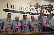 Jochen Schuemann holds aloft the America's Cup on the stage of the final press conference with from left, Russell Coutts, Brad Butterworth, Ernesto Berterelli and Michel Bonnefous. 2/3/2003 (© Chris Cameron 2003)