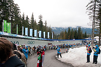 Spectators line the Whistler Sliding Centre course at the 4-man bobsleigh finals during the 2010 Olympic Winter Games in Whistler, BC Canada.