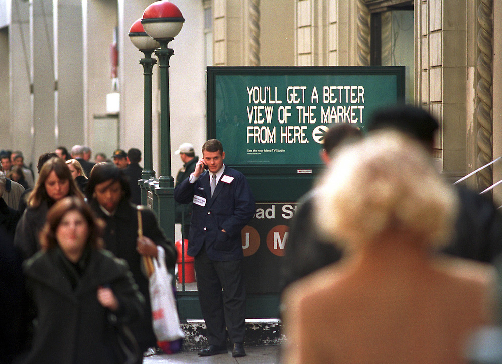 traders take a break outside the New York Stock Exchange..by Neville Elder 02/07/02