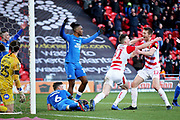 Doncaster Rovers defender Tom Anderson (12) and Doncaster Rovers defender Paul Downing (31) celebrates the equaliser scored by Doncaster Rovers midfielder Matty Blair (17) (not in picture)  1-1 during the EFL Sky Bet League 1 match between Doncaster Rovers and Peterborough United at the Keepmoat Stadium, Doncaster, England on 9 February 2019.