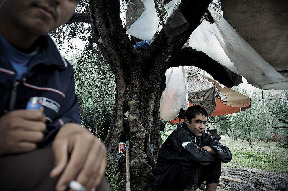 Into the jungle camp of Afghani refugees in the center of Patras Greece. Since there is not an immigration center or state facilities to host the immigrants arriving at Patras they have to leave outdoors under the trees or in self made huts...Many illegal immigrants still stay at Patras trying to find a way to go to Italy and other European countries. The situation in Greece, has become rough due to police violence, asylum granted with dropper, human rights violations, denial about the rights of migrants on their arrival. UNHCR has expressed its concern about the situation, the immigrants seem more optimistic after the change of Greek government but no one really wants to stay in the country for long.