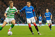 James Tavernier (C) of Rangers FC & Kristoffer Ajer of Celtic FC come together for the ball during the Betfred Scottish League Cup Final match between Rangers and Celtic at Hampden Park, Glasgow, United Kingdom on 8 December 2019.