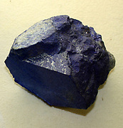 Lapis lazuli.  Decorative stone mainly composed of the mineral lazurite but contains inclusions of other minerals, such as calcite and pyrite.  It is often used for inlays and other decorative items.