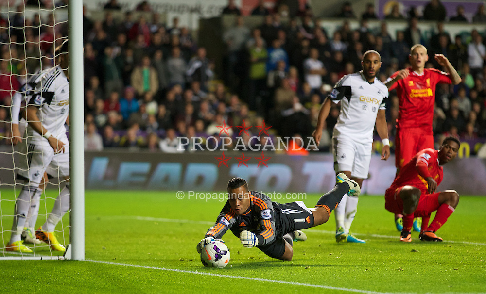 SWANSEA, WALES - Monday, September 16, 2013: Swansea City's goalkeeper Michael Vorm in action against Liverpool during the Premiership match at the Liberty Stadium. (Pic by David Rawcliffe/Propaganda)