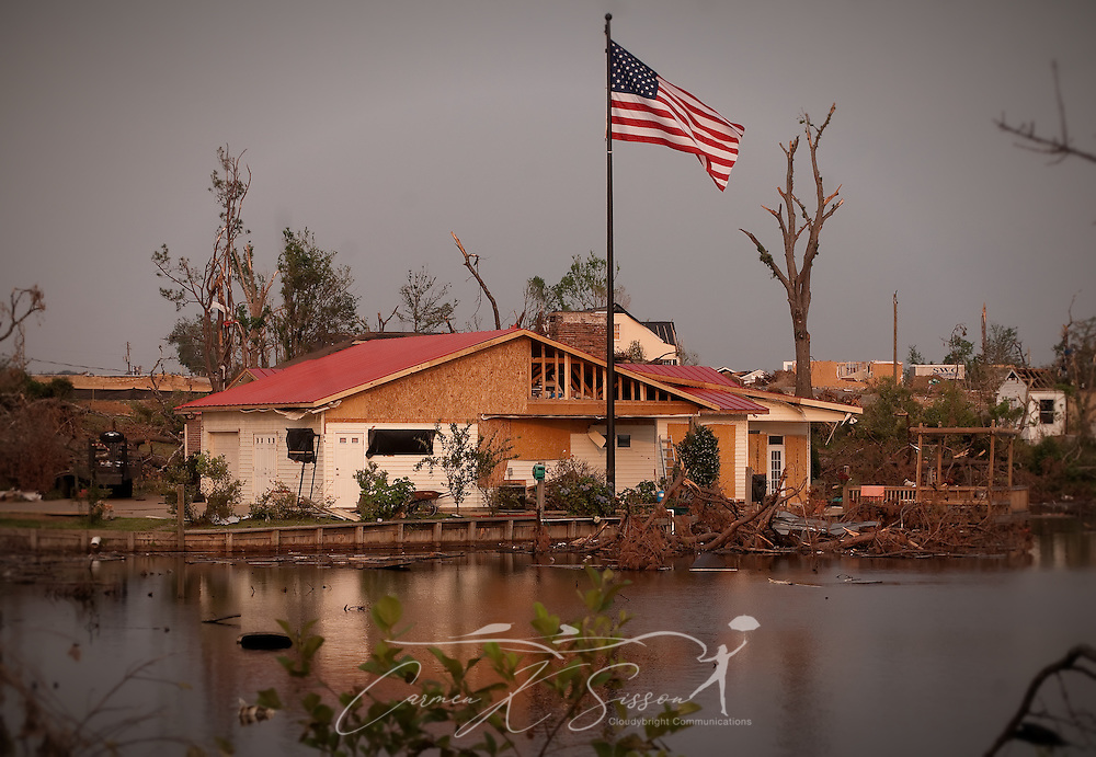 A new flag pole stands outside a Forest Lake home June 4, 2011 in Tuscaloosa, Ala. The subdivision was destroyed by the April 27 F-5 tornado which took 43 lives in Tuscaloosa. (Photo by Carmen K. Sisson/Cloudybright)