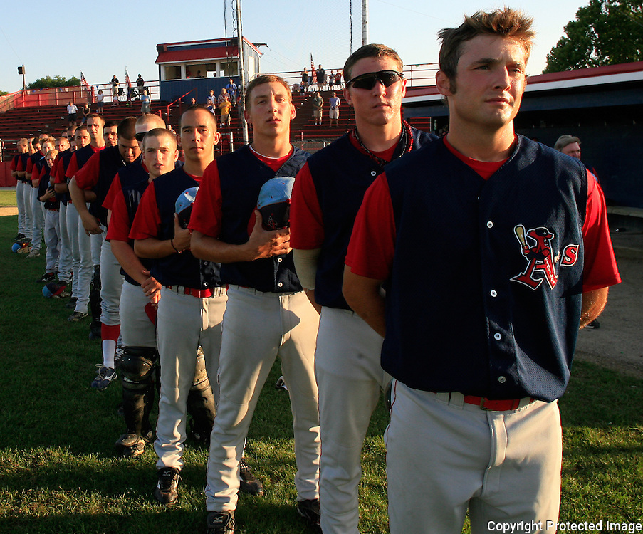 The Clarinda A's go hatless for the National Anthem before their game last June against the Omaha Diamond Spirit.  photo by David Peterson