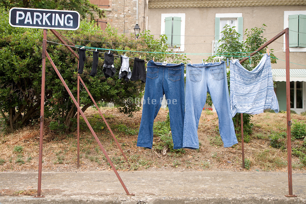 clothesline with clothing and parking sign
