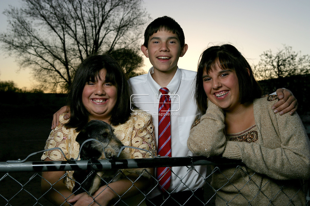 21st April 2008, Belen, New Mexico. Ray and Refugia Moore who adopted their three grandchildren: Samantha,(17) Gary (15) and Brandi (11). All three children have been diagnosed with a genetic heart defect. The two sisters have both had heart transplants and doctors agree Gary will most likely need a transplant too in order to remain alive.PHOTO © JOHN CHAPPLE / REBEL IMAGES.john@chapple.biz    www.chapple.biz