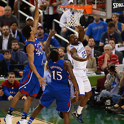 Apr 2, 2012; New Orleans, LA, USA; Kentucky Wildcats guard Marquis Teague (25) shoots a lay up as Kansas Jayhawks forward Kevin Young (40) and guard Elijah Johnson (15) defend during the first half in the finals of the 2012 NCAA men's basketball Final Four at the Mercedes-Benz Superdome. Mandatory Credit: Derick E. Hingle-US PRESSWIRE